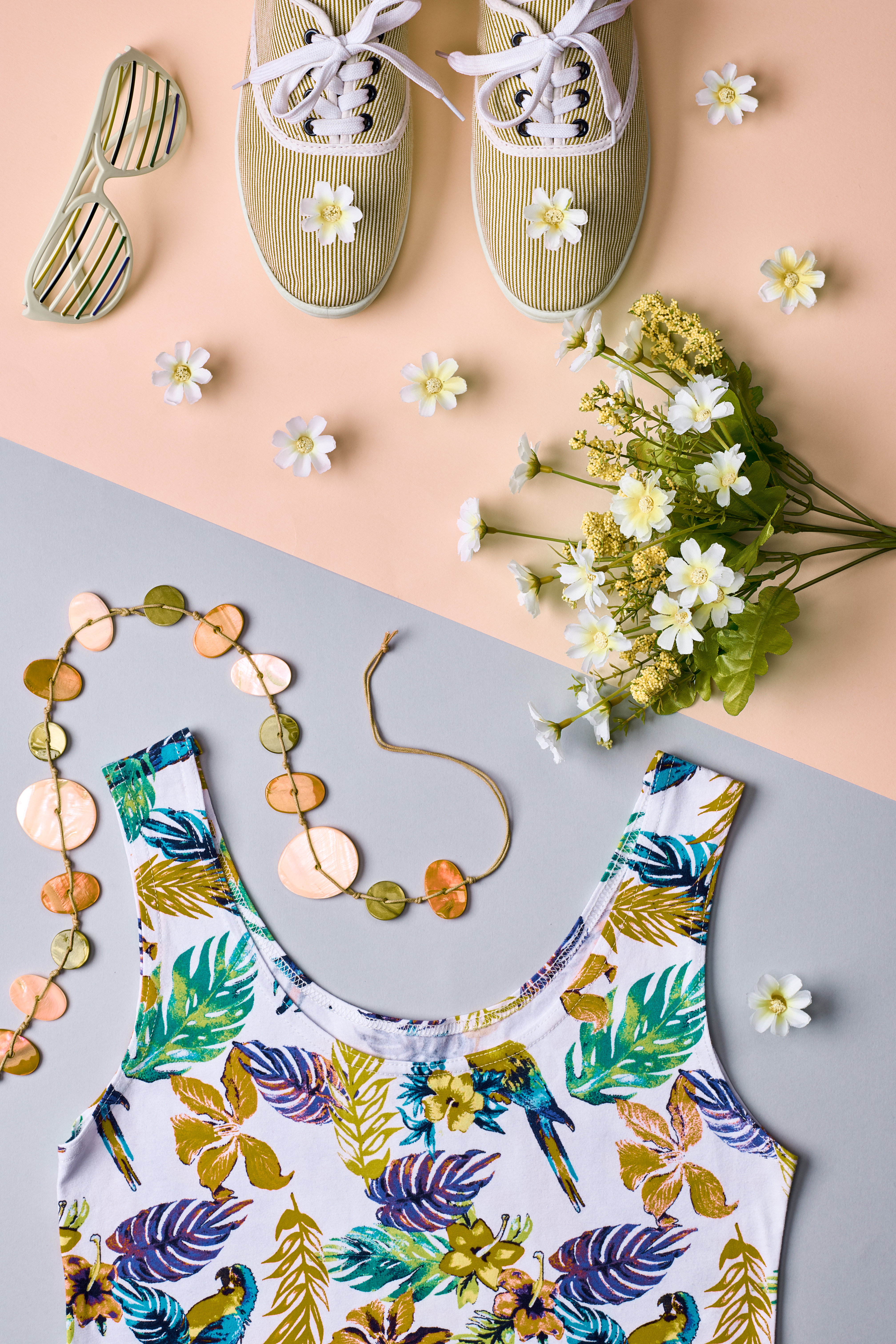 Overhead outfit Fashion girl clothes set, accessories. Creative hipster look, pastel colors. Stylish gumshoes, dress, sunglasses, flowers.Unusual modern summer essentials.Top view, pink background